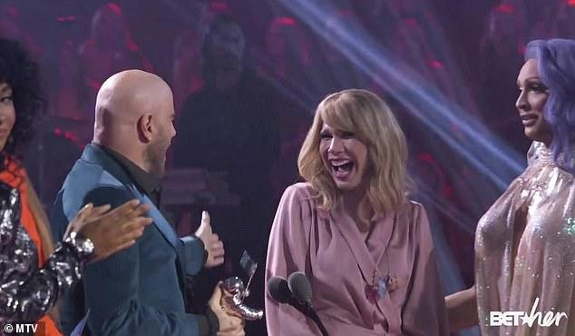 LOL – John Travolta Mistakes Drag Queen for Taylor Swift